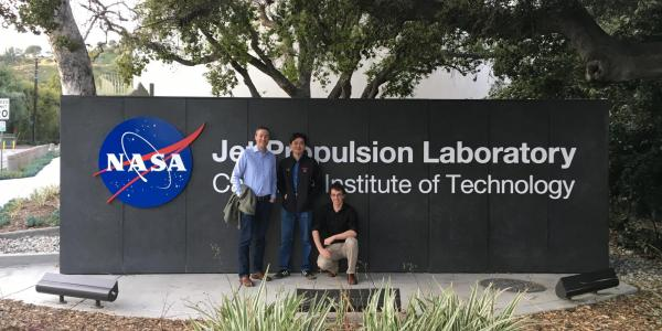 Greg Rieker and his students posing in front of the JPL sign