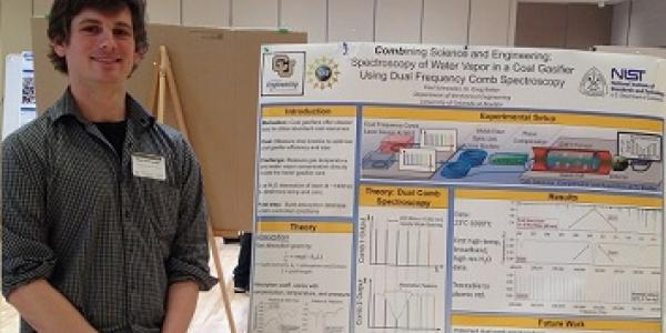Paul Schroeder with his winning poster at Energy Frontiers