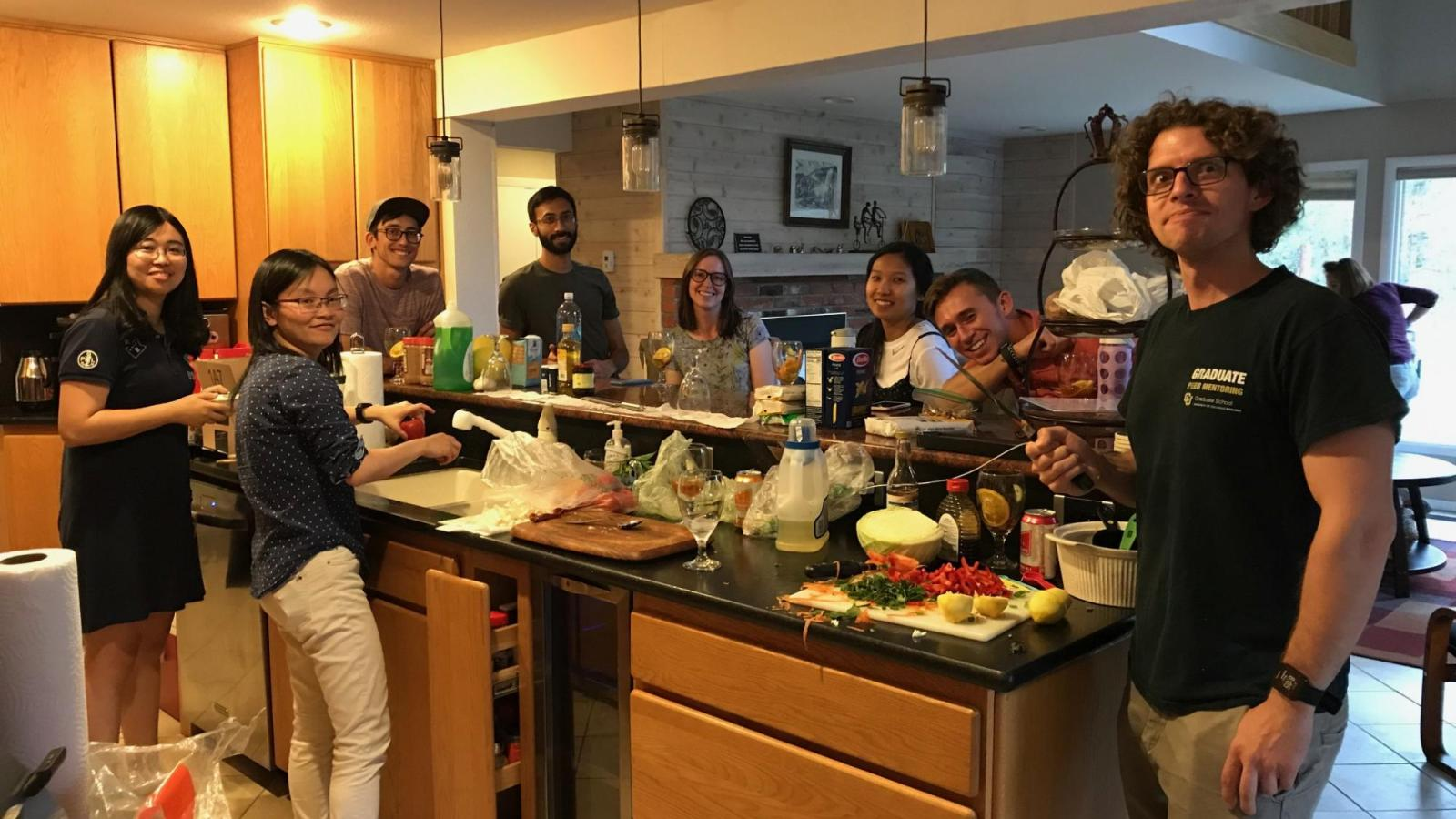 The Spencer Lab making dinner during the lab retreat in Keystone, Colorado.