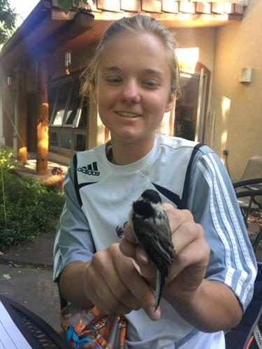 Katherine and a chickadee