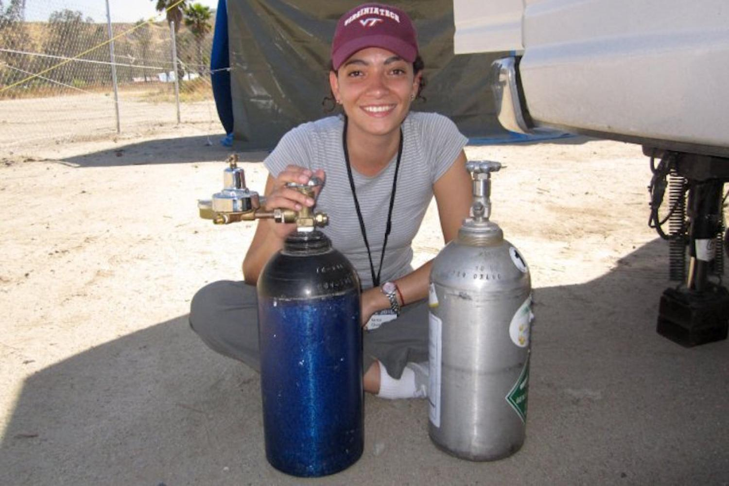 Dr. Vance with gas cylinders in Tijuana, Mexico for the Cal-Mex field campaign