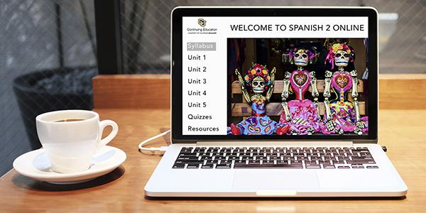 Computer displaying an online Spanish course