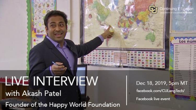 Photo of Akash Patel pointing to a world map in a classroom
