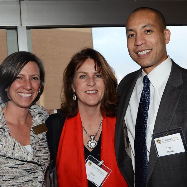 Banquet Chair Lucy Stark ('98), Darla Daniel ('01), and Law Alumni Board Chair Franz Hardy ('00)