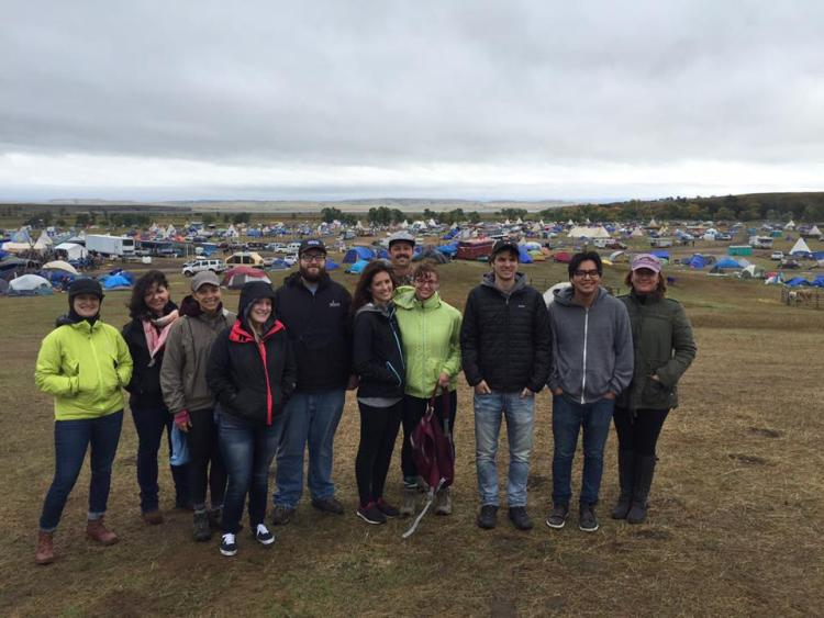 Associate Clinical Professor Carla Fredericks with American Indian Law Clinic students at the Oceti Sakowin Camp in North Dakota