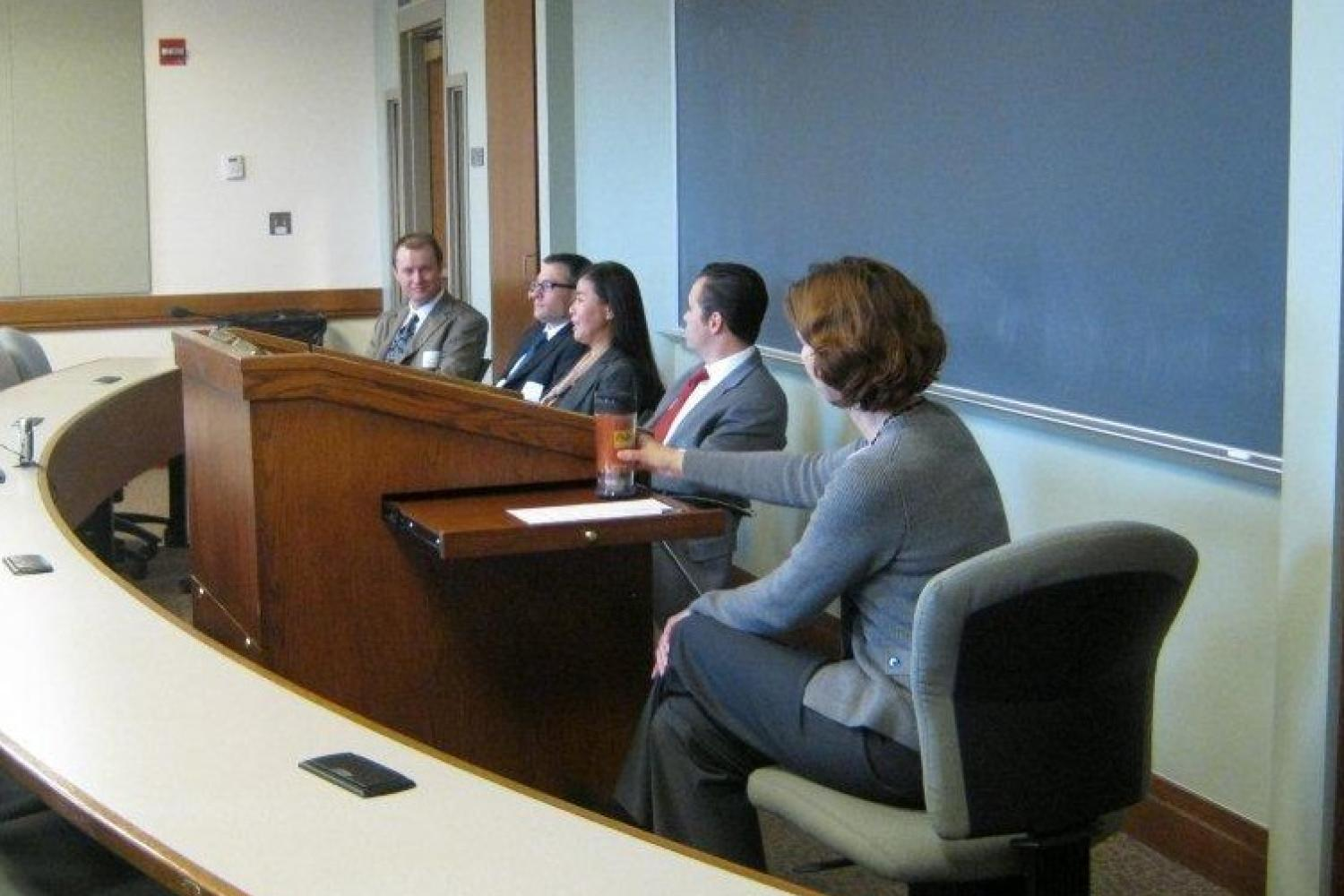 Judge John Madden (Denver District Court), Zach Carlyle (U.S. SEC), Misae Nishikura (Holland & Hart), and Dan McCormick (Kilpatrick Townsend) speak at the Interviewing Tips and Techniques Panel while Jennifer Winslow moderates.