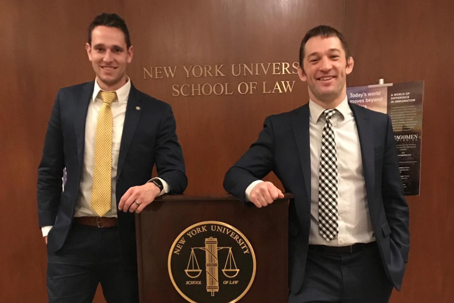 Photo of Travis Weiner and Adam Zenger at NYU Immigration Law Competition