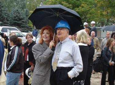 Marvin and Judi Wolf watching the topping out of the new Wolf Law Building in 2005.