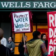 Dakota Access Pipeline protestors organize outside of a Wells Fargo