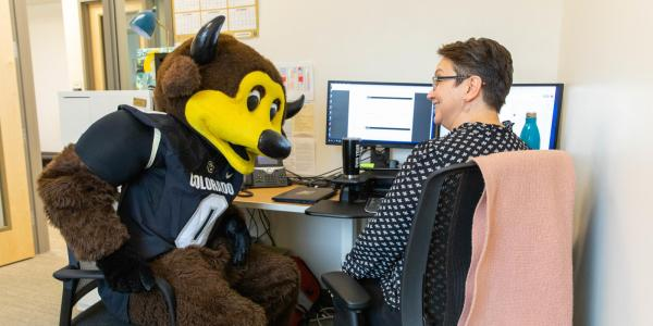 University Exploration and Advising Center Photo - Chip, the CU Mascot and an Advisor