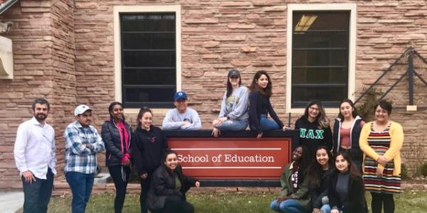 Students from the Multicultural Leadership Scholars program posing outside the School of Education