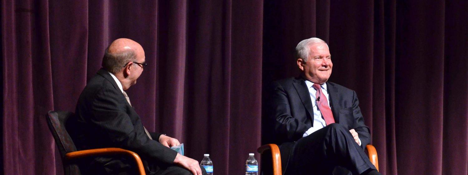 Dr. Robert Gates on stage with Chancellor Phil DiStefano