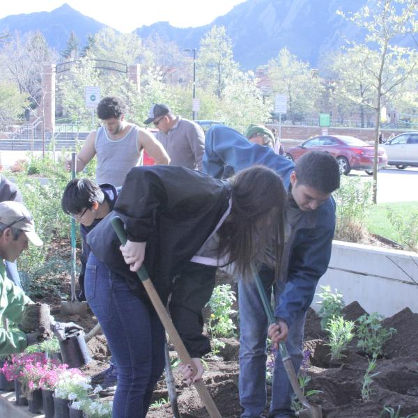 students planting a garden