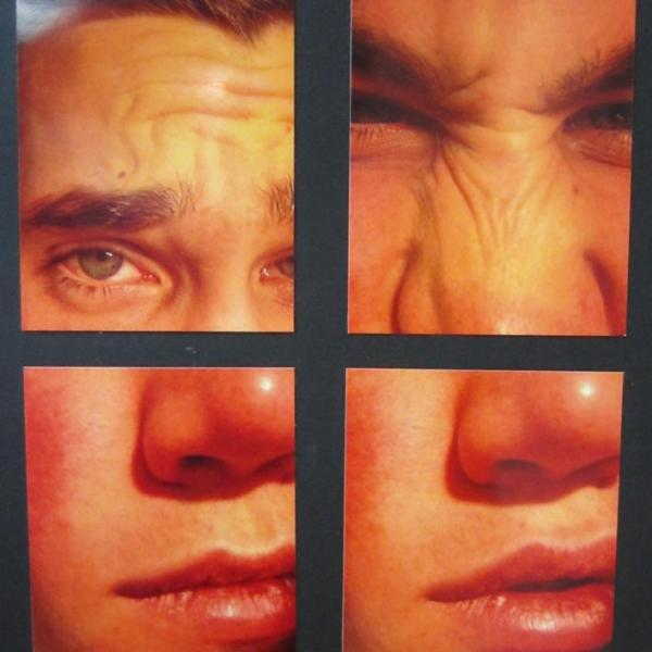 a collection of four pictures of a male face put together to create a portrait