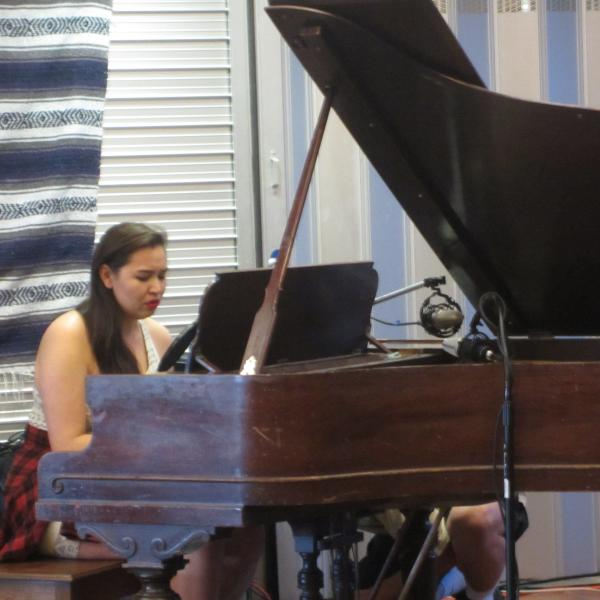 Student playing on piano
