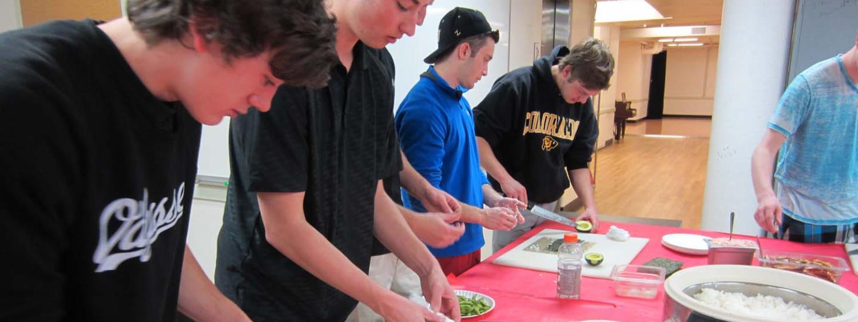 Students preparing sushi