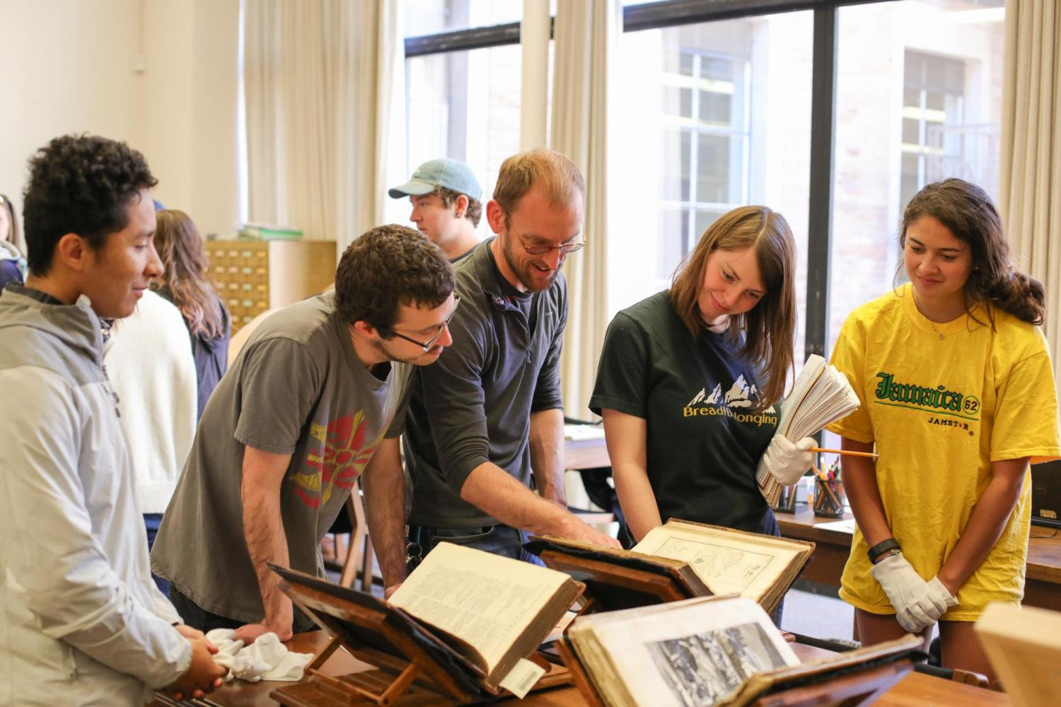 Librarian Adam Lisbon shows students from Asian Languages and Civilizations materials from Special Collections.