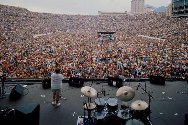 view of Folsom Field filled with a large crowd of people waiting for a music concert