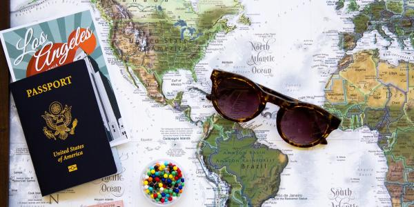 A map, passport, sunglasses