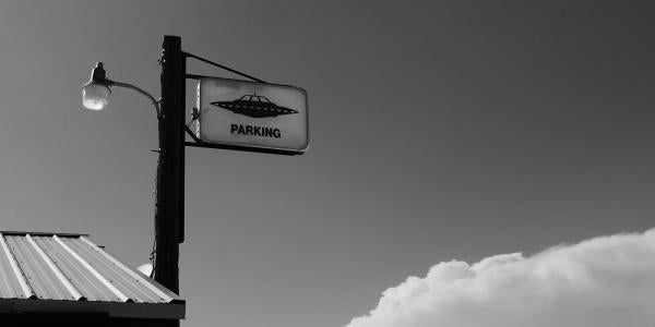 A sign that says UFO parking