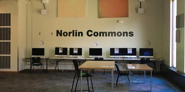 Computers, tables and chairs.
