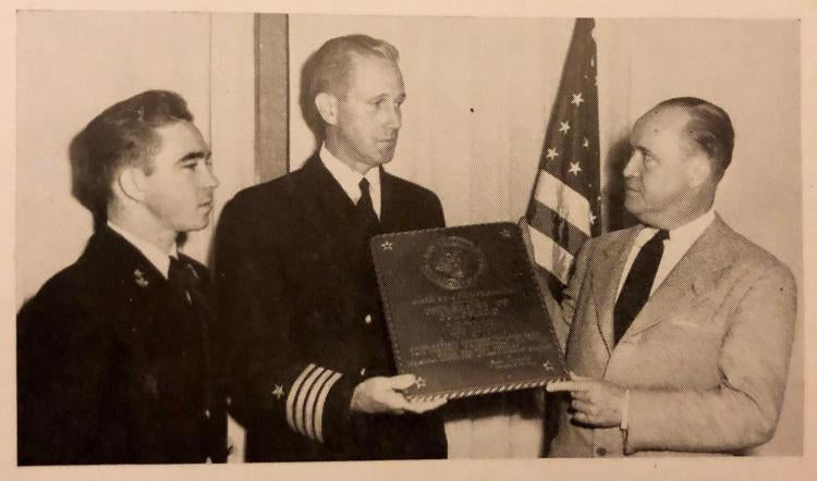 """Admiring Navy Plaque Presented To The University Are Membership Man Richard L. Alford, Capt. Clifford A. Fines, And President Robert L. Stearns."