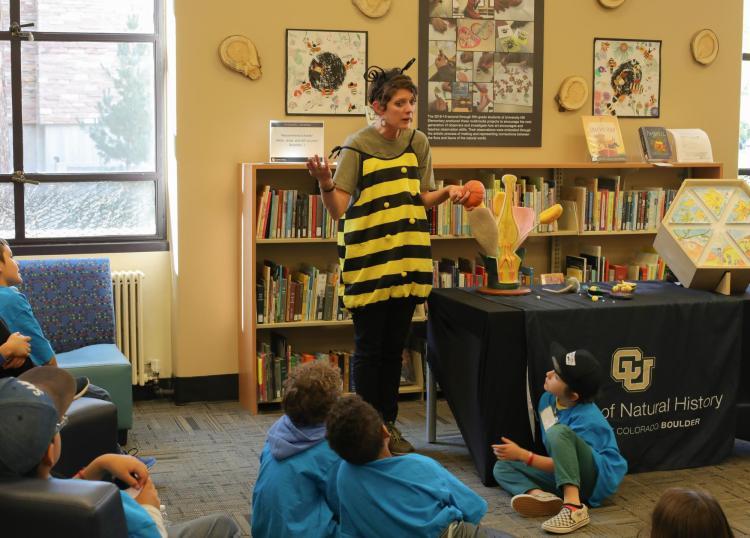 Elementary school students listen to bee in STEAM gallery
