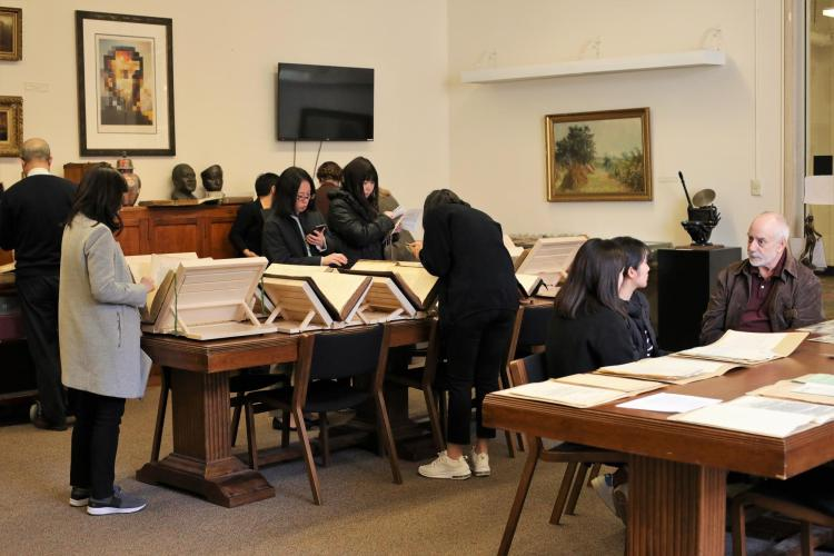 Members of CEAL look through the University Libraries' Asian Studies collection.