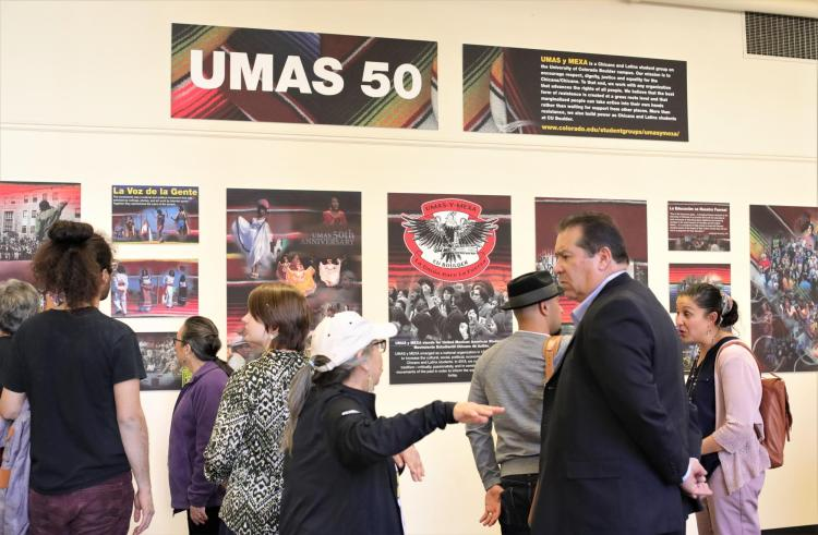 Attendees examine and discuss the panel exhibit.