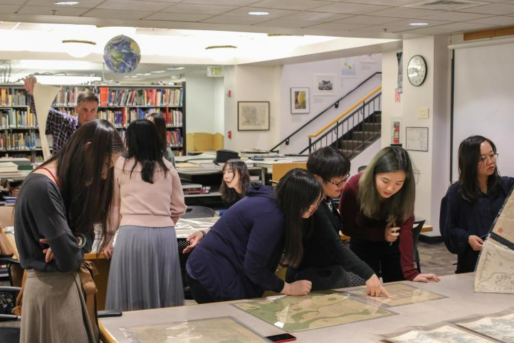 An interdisciplinary class in the Map Library.
