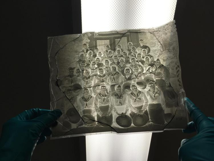 A large negative that will be digitized after being cleaned and restored a bit by preservation.
