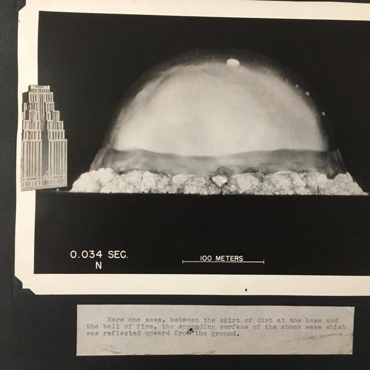 Image of the Trinity Test blast from July 16, 1945 with a building for scale
