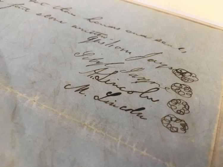 Closeup on Abraham Lincoln and Mary Todd Lincoln's signatures