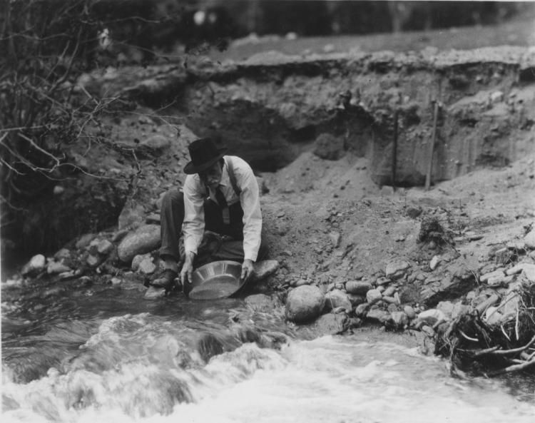 An older man panning for gold, unknown date