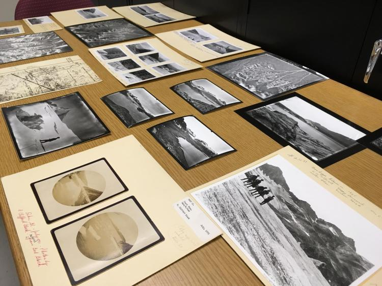 Several photos from the Glacier Collection spread across a table.