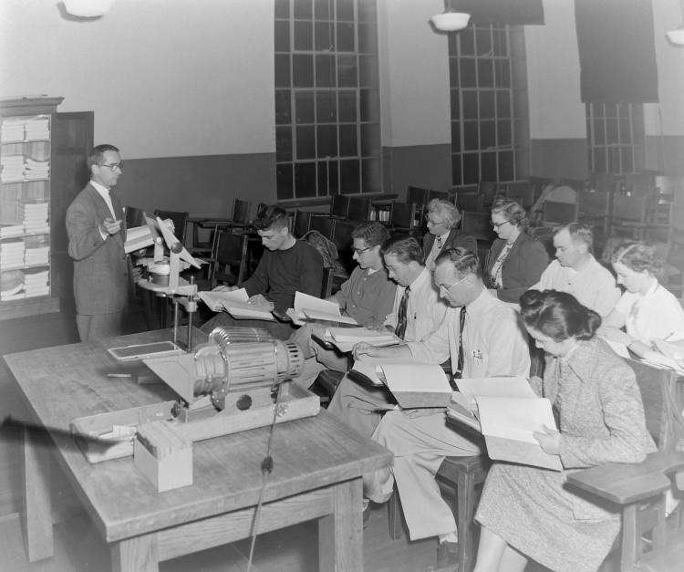 Students reading in class in the 1950s.