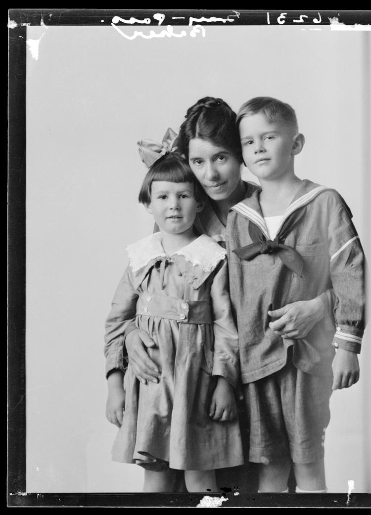 Mother with her daughter and son by Charles Snow, photographer.