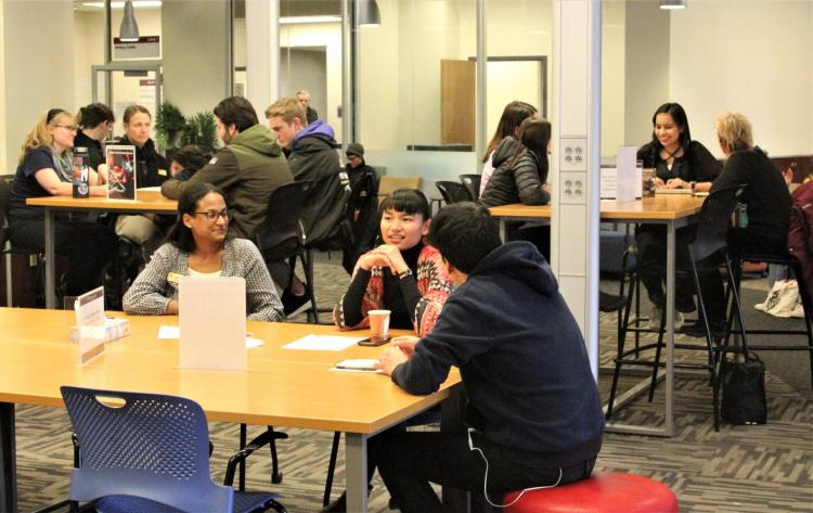 Readers engaged in dialogue with Readers and Monitors in Norlin Commons on Wednesday.
