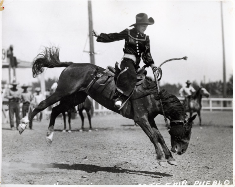 Rodeo performer Mayme Stroud riding bronco at the Colorado State Fair and Rodeo, undated