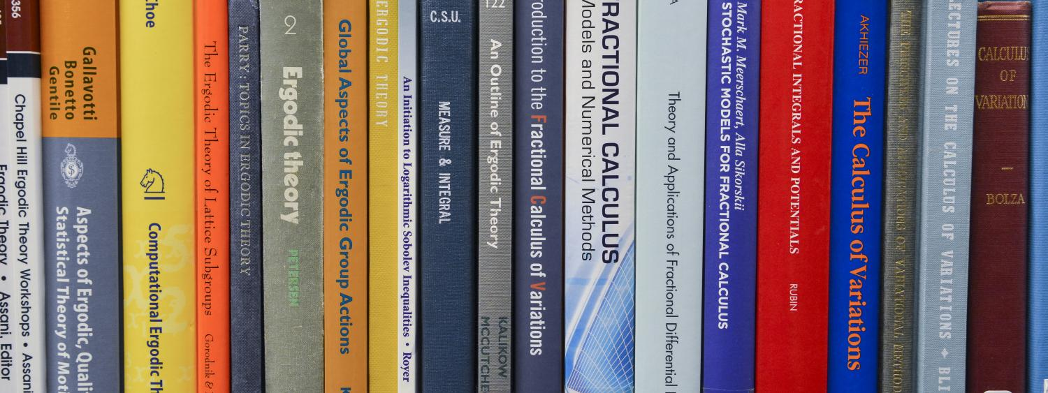 Engineering, Math and Physics books on a shelf.
