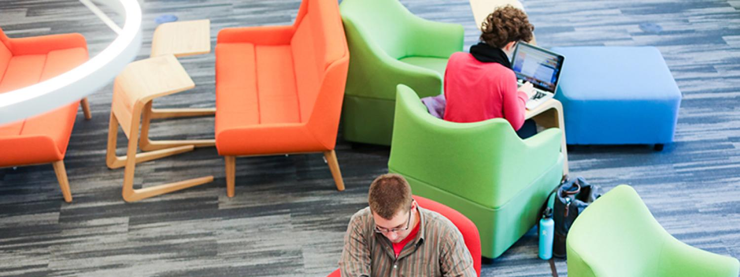 Two students working in the renovated Music Library