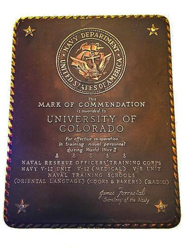 The rediscovered plaque presented to the University of Colorado Boulder in 1947 by Presentation of Navy Department Plaque to University of Colorado Boulder by Captain Clifford A. Fines.