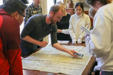 Librarian Adam Lisbon shows how a Google Map aligns with a 1700s map.