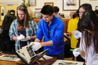 Students explore Special Collections materials on Japan.