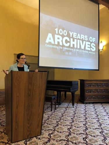 Head of Archives Megan Friedel speaks to the large group.