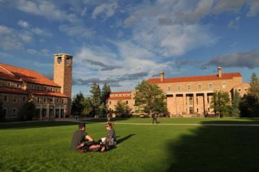Students in Norlin Quad with the Library in the background