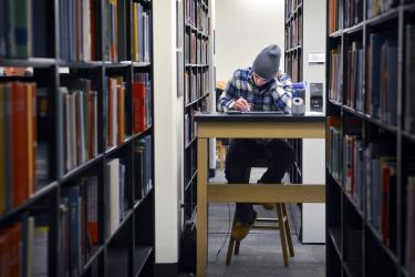 Student Studying in the stacks of Gemmill Library