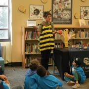 Elementary school students listen to bee in STEAM gallery