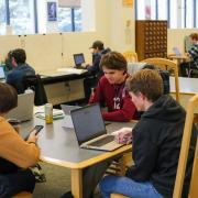 Students studying together at a table in Gemmill Library.