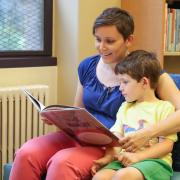 Music Librarian Stephanie Bonjack reading a children's book to her child.